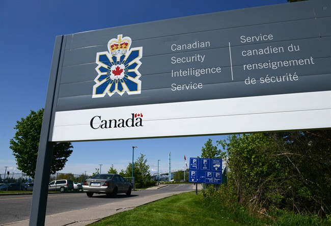 A sign for the Canadian Security Intelligence Service building is shown in Ottawa on May 14, 2013. The New Democrats want to scrap proposed new powers for the Canadian Security Intelligence Service, bolster review of intelligence activities and enhance anti-radicalization programs.