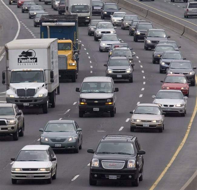Traffic moves along a congested highway in Toronto, on April 26, 2007.