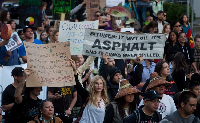 Protesters march during a rally held to show opposition to the Enbridge Northern Gateway pipeline in Vancouver, B.C., on June 17, 2014.
