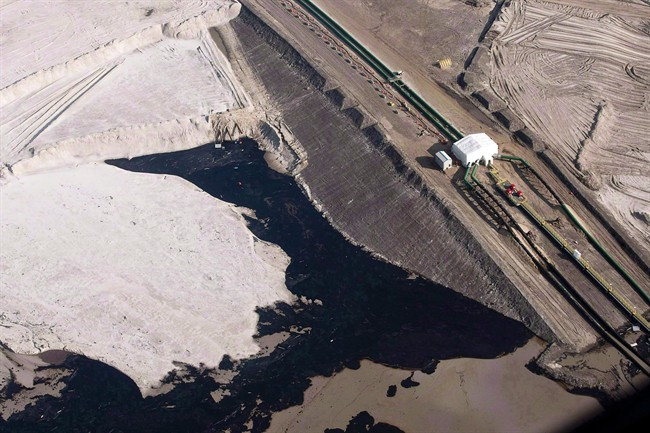 An oilsands facility is seen from a helicopter near Fort McMurray, Alta., Tuesday, July 10, 2012. The latest ideas on improving the environmental performance of Alberta's oilsands are being presented at a conference in Edmonton.
