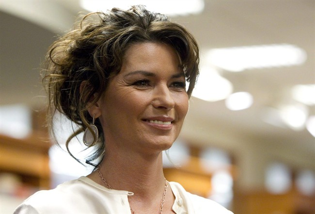 """Shania Twain arrives to sign copies of her new book """"From This Moment On"""" in Toronto Monday, May 9, 2011."""