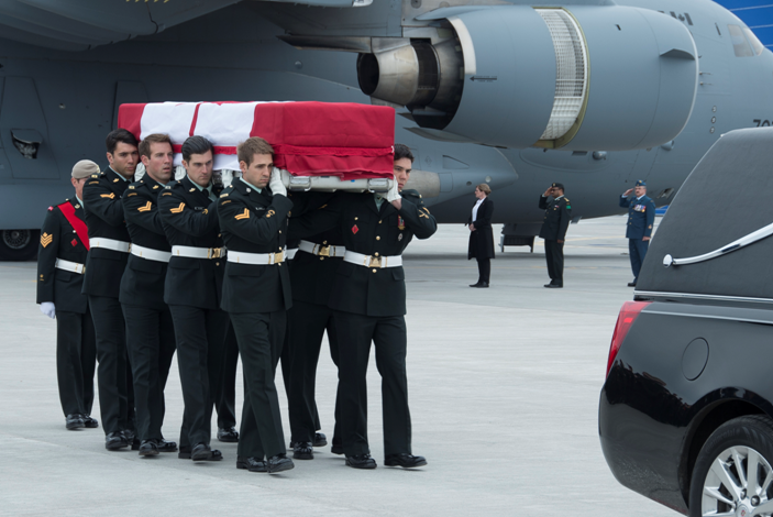 Military pallbearers from the Canadian Special Operations Forces Command carry the flag-draped casket of Sgt. Andrew Joseph Doiron.