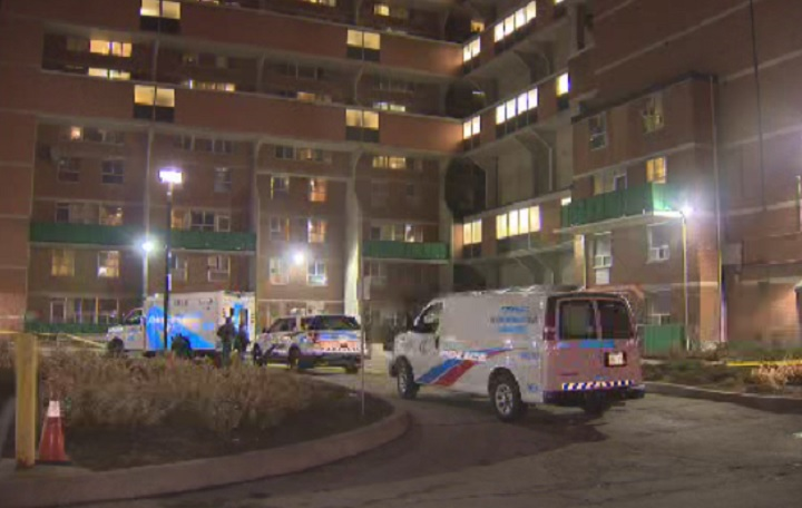 Police investigate a shooting at an apartment building on Islington in west-end Toronto on March 17, 2015.