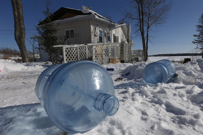 Empty 20 litre water bottles sit outside Laura Green's house waiting for pickup and refilling Wednesday, February 25, 2015. The Shoal Lake community, despite supplying water to the city of Winnipeg, is under a boil water advisory and lacks year round road access.