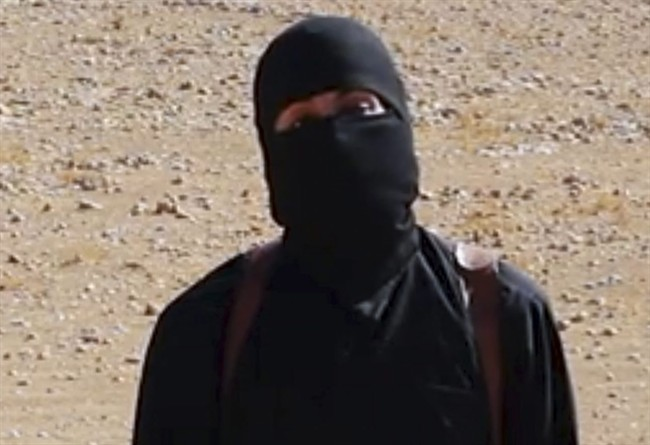 FILE - This undated image shows a frame from a video released Friday, Oct. 3, 2014, by Islamic State militants that purports to show the militant who beheaded of taxi driver Alan Henning.
