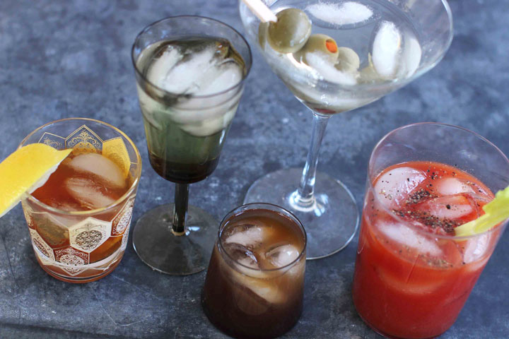 """This March 23, 2015 photo shows mixed cocktails, from left, an old fashioned, a vodka gimlet, a Bull Shot, a dry martini and a bloody mary. """"The culture of the cocktail really exploded in the '60s,"""" says Maureen Petrosky, author of """"The Cocktail Club."""" Suddenly there were cocktail dresses, new glassware, bar couture, Tiki drinks. The cocktail hour had its own wardrobe."""