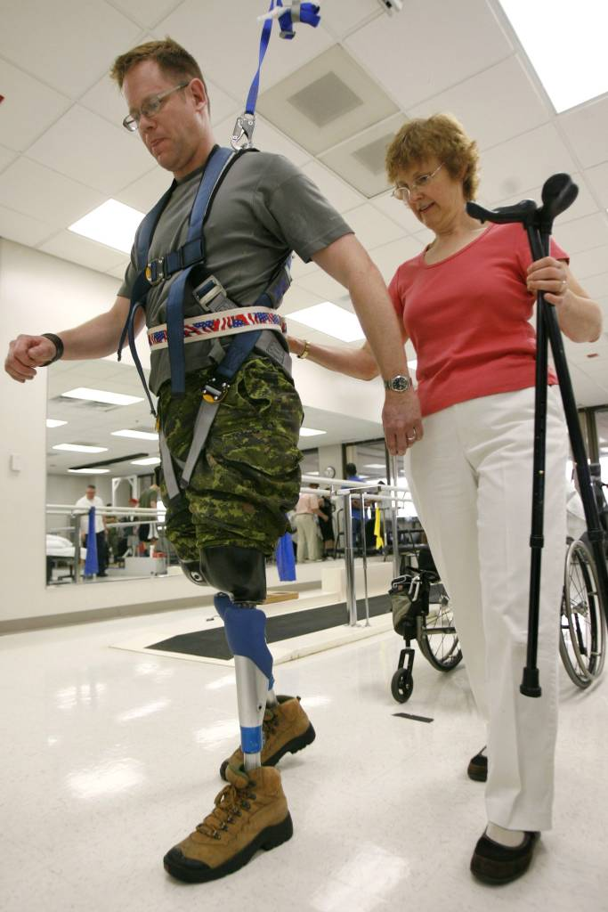 Canadian Master Corp. Paul Franklin with his physical therapist, Bev Agur, of Edmonton, Canada, at Walter Reed Army Medical Center in Washington on Tuesday, April 24, 2007. Franklin lost both legs above the knee while serving in Afghanistan in 2006. He was Canada's first war amputee since the Korean War. (AP Photo/Jacquelyn Martin)