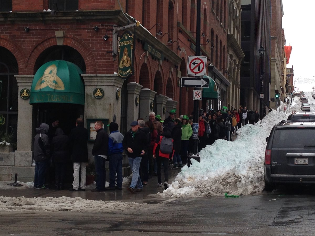 People are eager to go into the Old Triangle pub on St. Patrick's Day 2015.