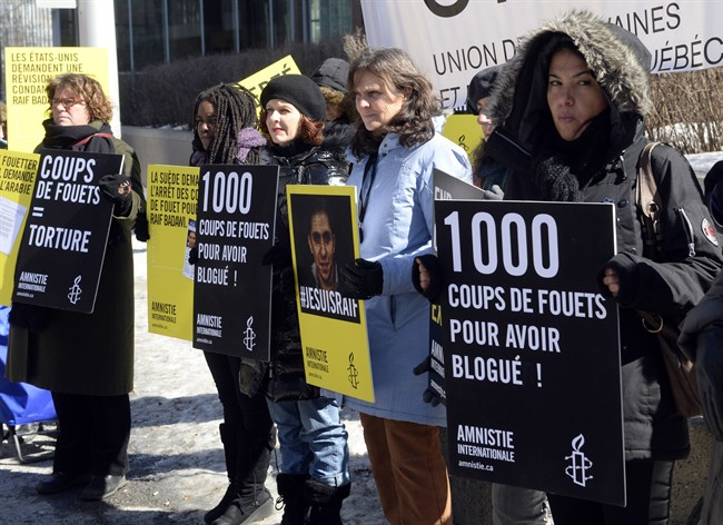 Supporters of Raif Badawi take part in a rally for his freedom Thursday, March 12, 2015 in Montreal. Badawi was sentenced last year to 10 years in prison, 1,000 lashes and a fine of one million Saudi Arabian riyals (about $315,000 Cdn) for offences including creating an online forum for public debate and insulting Islam. (File photo).