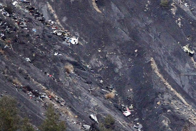 Debris of the Germanwings passenger jet is scattered on the mountain side near Seyne les Alpes, French Alps, Tuesday, March 24, 2015. A Germanwings passenger jet carrying at least 150 people crashed Tuesday in a snowy, remote section of the French Alps, sounding like an avalanche as it scattered pulverized debris across the mountain.