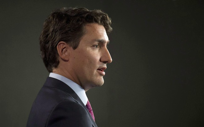 Liberal Leader Justin Trudeau speaks with the media following caucus Wednesday March 25, 2015 in Ottawa.