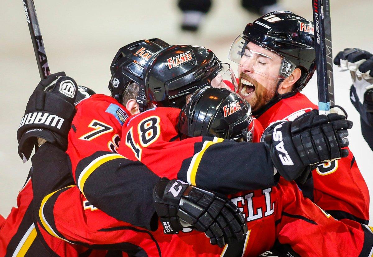 Calgary Flames Matt Stajan celebrates his game-winning goal with teammates .