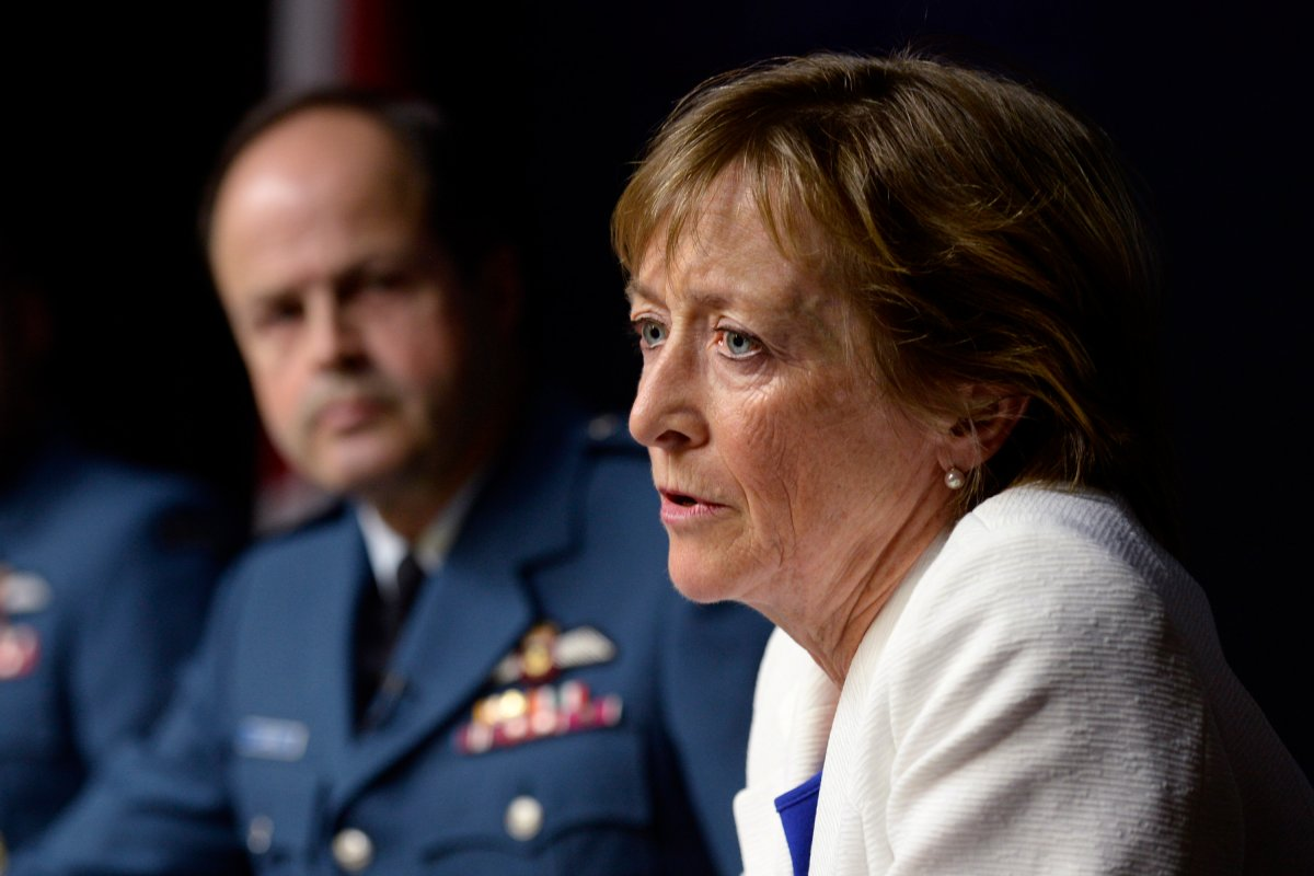 Marie Deschamps, a former Supreme Court justice and author of an inquiry into sexual misconduct in the Canadian Forces, speaks at a news conference in Ottawa on Thursday, April 30, 2015. General Tom Lawson, Chief of the Defence Staff, is at left.