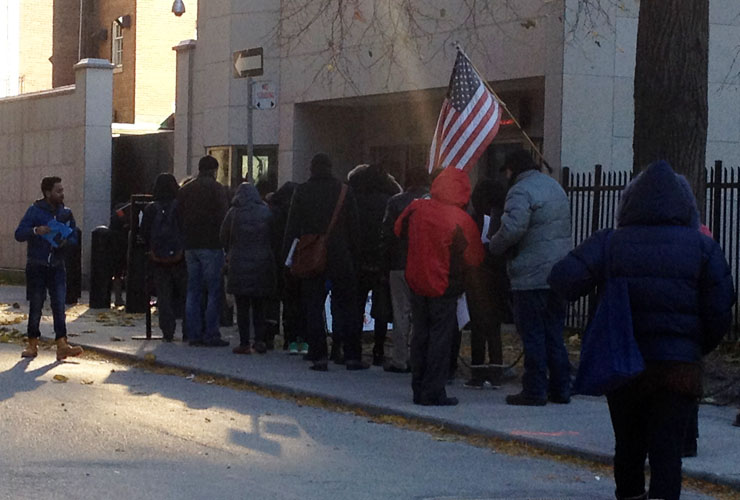 A line of people waits to enter the U.S. consulate in Toronto in November, 2014.