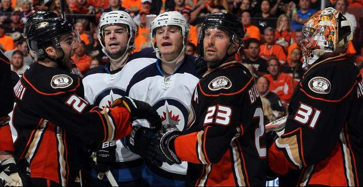 Drew Stafford and Mark Scheifele of the Winnipeg Jets make their points to the referee with Kyle Palmieri and Francois Beauchemin and goalie Frederik Andersen of the Anaheim Ducks looking on during the second period in Game One of the Western Conference Quarterfinals during the 2015 NHL Stanley Cup Playoffs.