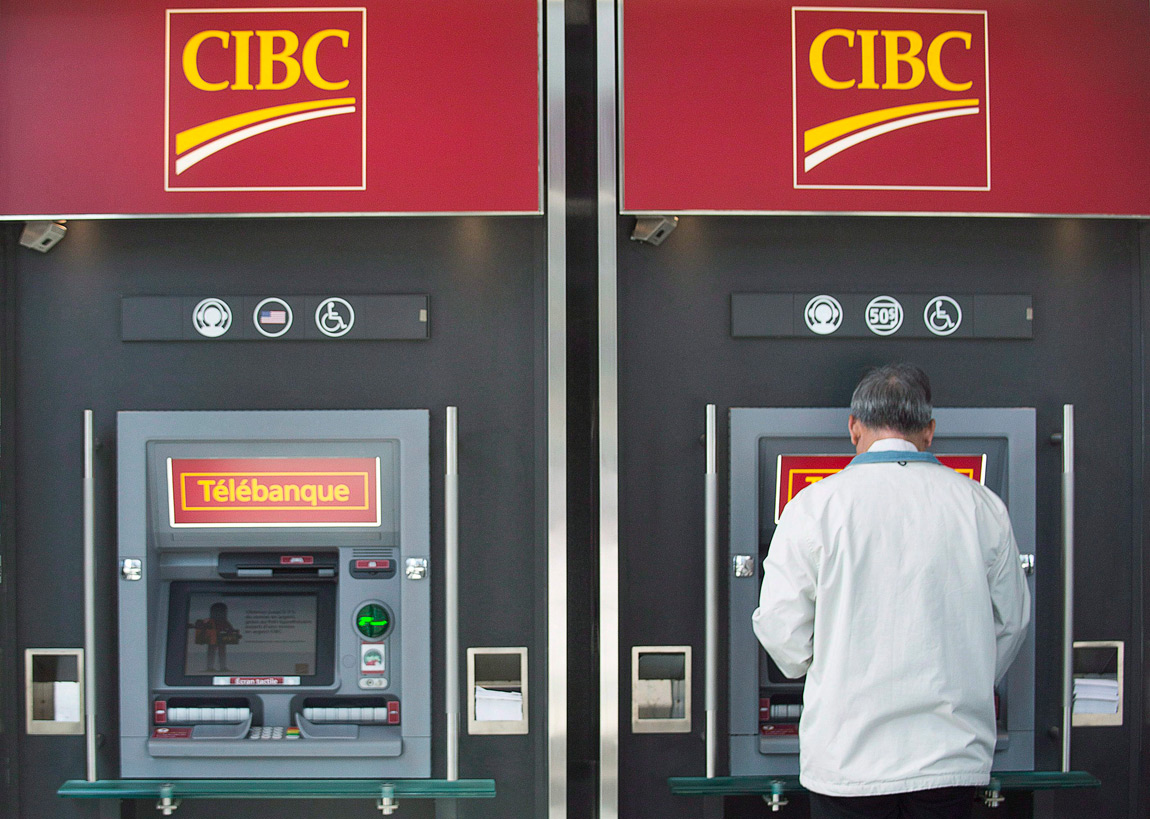 A man uses an ATM at a CIBC branch in Montreal, on April 24, 2014.