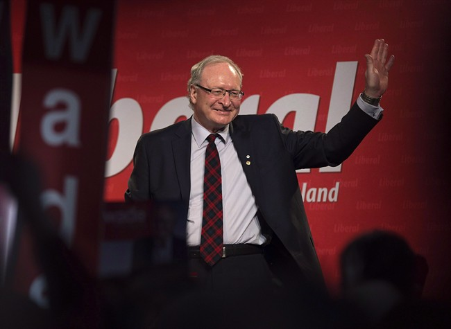 Wade MacLauchlan waves to the crowd as he is acclaimed leader at the Prince Edward Island Liberal leadership convention in Charlottetown on Feb. 21, 2015.