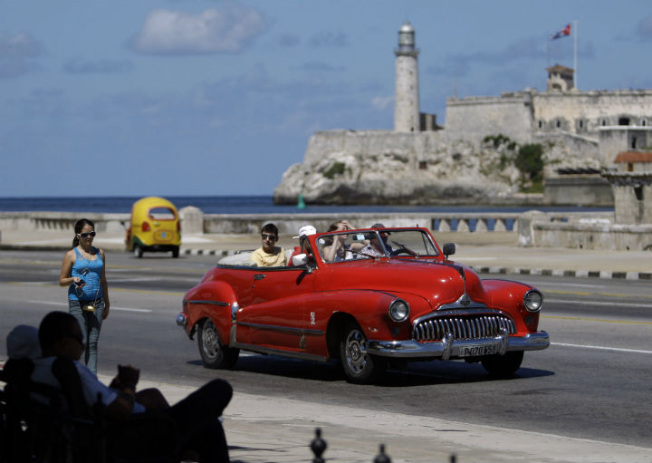 Tourists ride in a classic American car on the Malecon in Havana, Cuba. A new set of U.S. government regulations took effect  Jan. 16, 2015, severely loosening the 50-decade long travel and trade restrictions for Cuba.