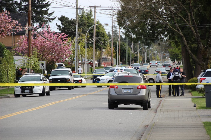 Police investigate a shooting in the 7000 block of 130th Street on April 12, 2015.