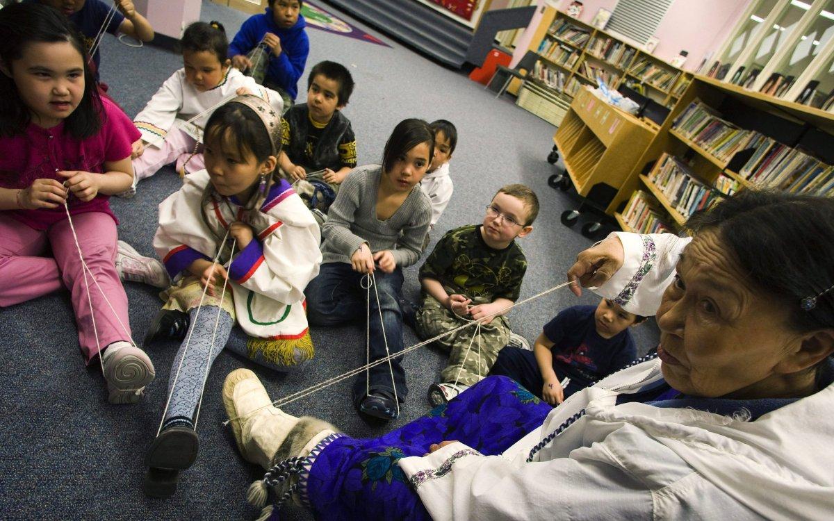 Inuktitut elder Siipa Isullatak teaches children how to sew, at the Nakasuk Elementary School in Iqaluit, Nunavut on Wednesday, April 1, 2009.