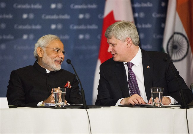 Canadian Prime Minister Stephen Harper, right, participates in a business roundtable with India's Prime Minister Narendra Modi, left, in Toronto on Thursday, April 16, 2015. THE CANADIAN PRESS/Michelle Siu.