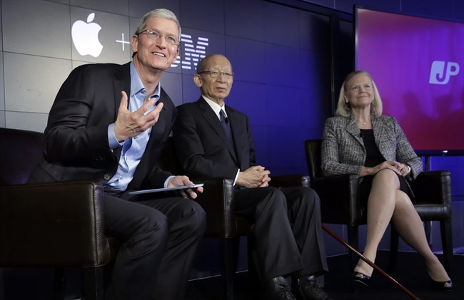 Apple CEO Tim Cook, left, addresses a news conference, joined by Japan Post CEO Taizo Nishimuro, and IBM CEO Ginni Rometty, at IBM Watson headquarters, in New York, Thursday, April 30, 2015. Apple, IBM and Japanese insurance and bank holding company Japan Post have formed a partnership to improve the lives of elderly people in the country. The program will provide iPads with apps designed to help seniors manage day-to-day lives and keep in touch with family members.