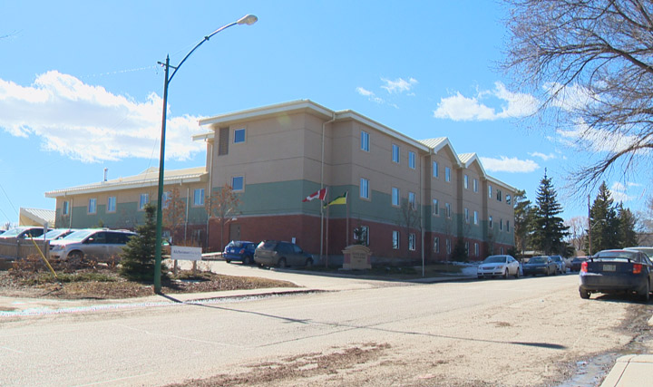 A care aide worker at Saskatoon's Oliver Lodge suspended with pay says it's because he spoke out; officials say it's unrelated to his public comments.