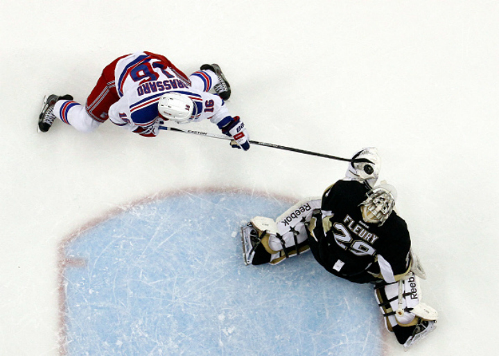 :PITTSBURGH, PA - APRIL 20: Marc-Andre Fleury #29 of the Pittsburgh Penguins makes a save on Derick Brassard #16 of the New York Rangers in Game Three of the Eastern Conference Quarterfinals during the 2015 NHL Stanley Cup Playoffs at Consol Energy Center on April 20, 2015 in Pittsburgh, Pennsylvania.