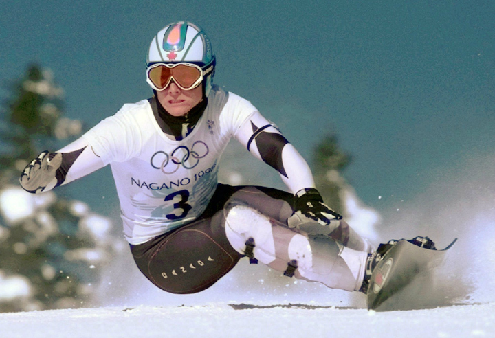 Ross Rebagliati of Canada skis to victory in the first-ever Men's Giant Slalom snowboarding competition Sunday Feb. 8, 1998 in Yamanouchi, Japan.