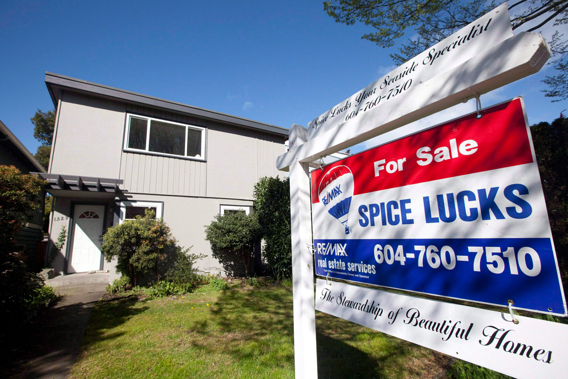 A for sale sign sits outside a home in Vancouver on April 8, 2010.