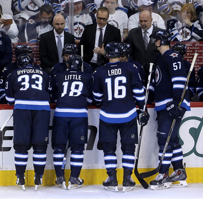 Winnipeg Jets head coach Paul Maurice instructs the team during a timeout while playing against the Anaheim Ducks during the third period of game three.