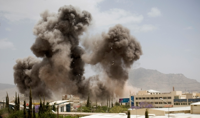 Smoke billows from a Saudi-led airstrike on Sanaa, Yemen, Wednesday, April 8, 2015. A state-run broadcaster in Iran is reporting that the Islamic Republic has sent a navy destroyer and another vessel to waters near Yemen amid a Saudi-led airstrike campaign.