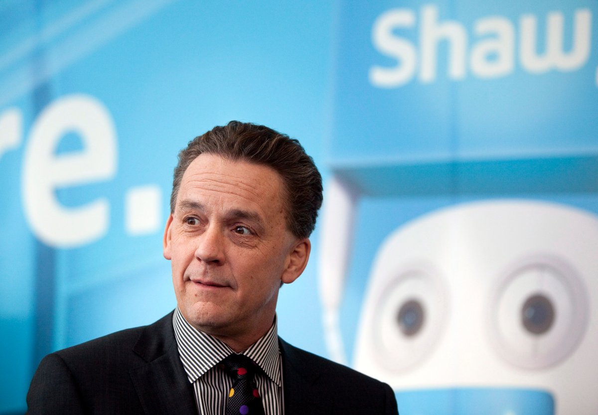 Brad Shaw, CEO of Shaw Communications, talks with shareholders before addressing the company's annual meeting in Calgary, Wednesday, Jan. 9, 2013.