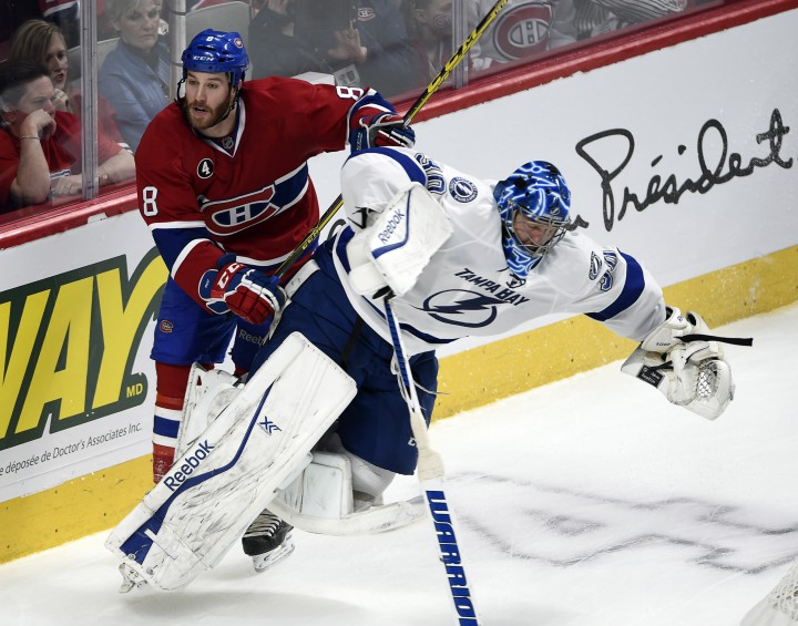 Montreal Canadiens winger Brandon Prust (8) runs into Tampa Bay Lightning goalie Ben Bishop (30) during third period of Game 2 NHL second round playoff hockey action Sunday, May 3, 2015 in Montreal.