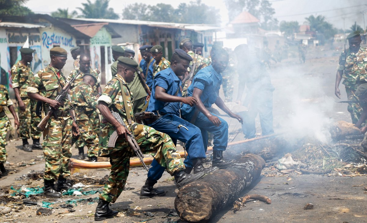Police and army clear barricades set by opposition demonstrators in the Cibitoke district of the capital Bujumbura, in Burundi Monday, May 25, 2015.