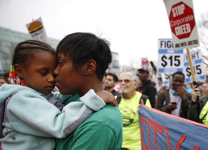 Latrese Williams of Dedham snuggled with her daughter, Desirae Shealey, 4, at a rally against income inequality in Boston on April 14, 2015.