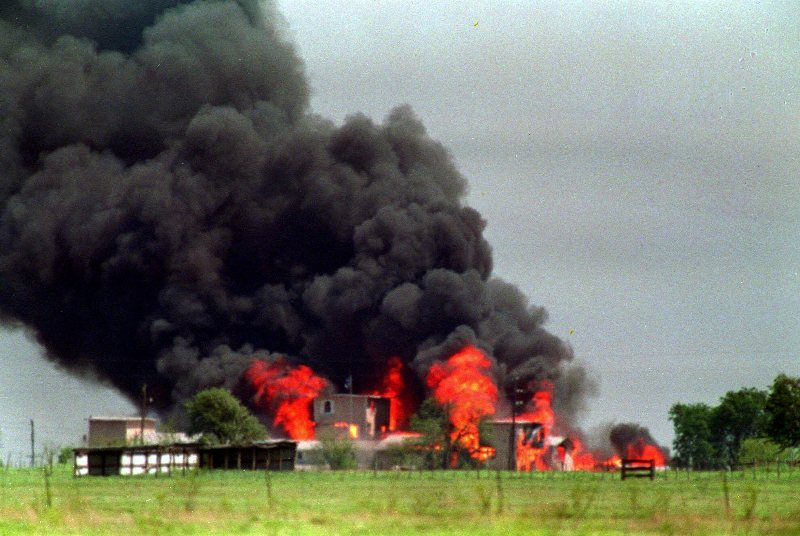 The Branch Davidian compound in Waco, Texas, is shown engulfed by flames in this April 20, 1993, photo. Retreating from its past denials, the FBI is acknowledging that federal agents fired one or more incendiary tear gas canisters during the standoff with Branch Davidians, while maintaining its stance that it did not start the fire that consumed the compound with Koresh and more than 80 followers inside.