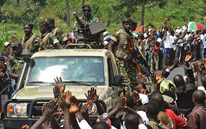 Soldiers lead the convoy of Burundi's President Pierre Nkurunziza's party, CNDD-FDD (National Council for the Defense of Democracy, Forces for the Defense of Democracy), during a rally outside Bujumbura on May 23, 2015.