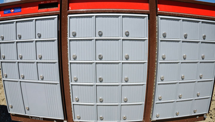 A distorted view of a Canada Post super mailbox in a new suburban development, Calgary, Alta., August 20, 2013. THE CANADIAN PRESS IMAGES/Bayne Stanley.