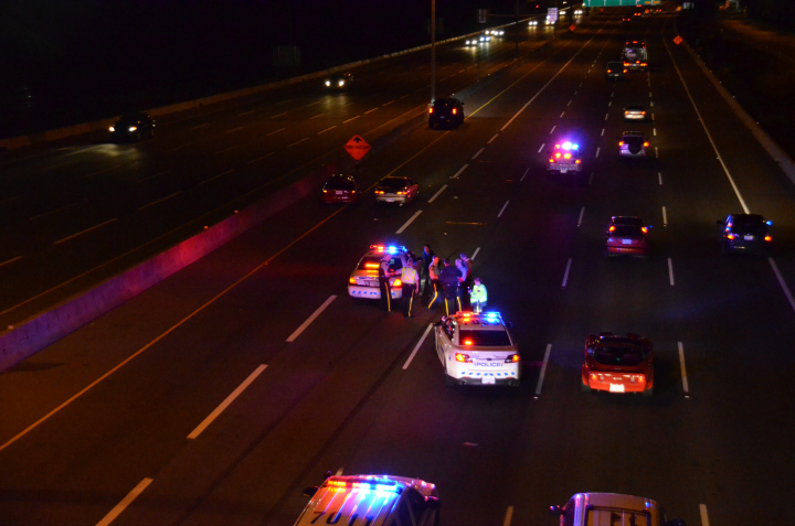 Police have confirmed that a woman was struck while trying to cross Highway 1 in Coquitlam Tuesday night.