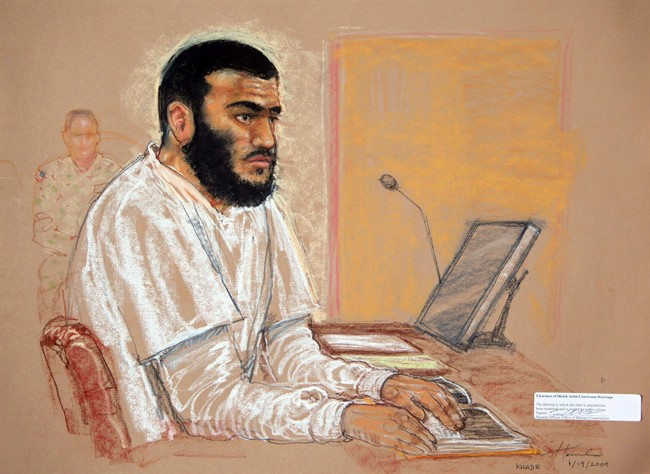 Canadian defendant Omar Khadr sits during a hearing at the U.S. Military Commissions court for war crimes, at the U.S. Naval Base, in Guantanamo Bay, Cuba, Jan. 19, 2009.  THE CANADIAN PRESS/AP, Janet Hamlin, Pool.