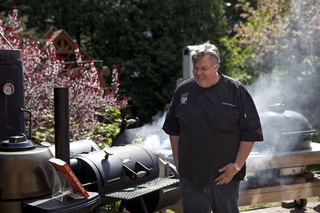 """Ted Reader, author of the recent book """"Gastro Grilling"""" fires up a charcoal grill in Toronto on Wednesday May 15, 2013."""