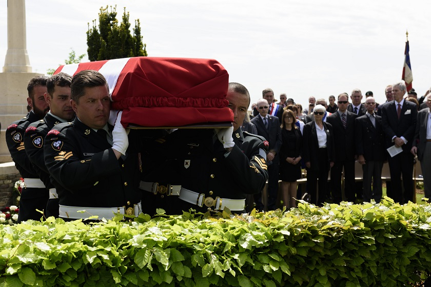 Members of the burial party from the Second Battalion Princess Patricia's Canadian Light Infantry carry an unknown soldier to his final resting place.