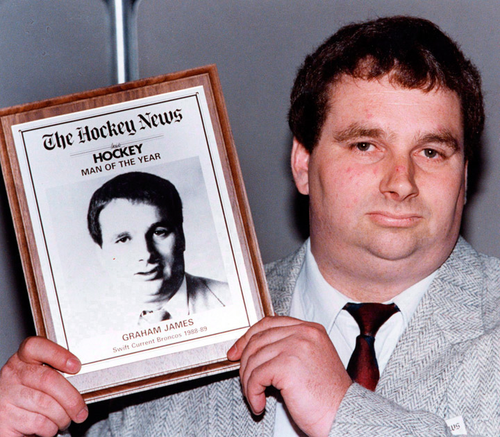 Graham James holds his Hockey News award in Toronto, June 8, 1989. The Hockey News says twice-convicted pedophile Graham James has returned a plaque the magazine gave him in his heyday as a junior coach.