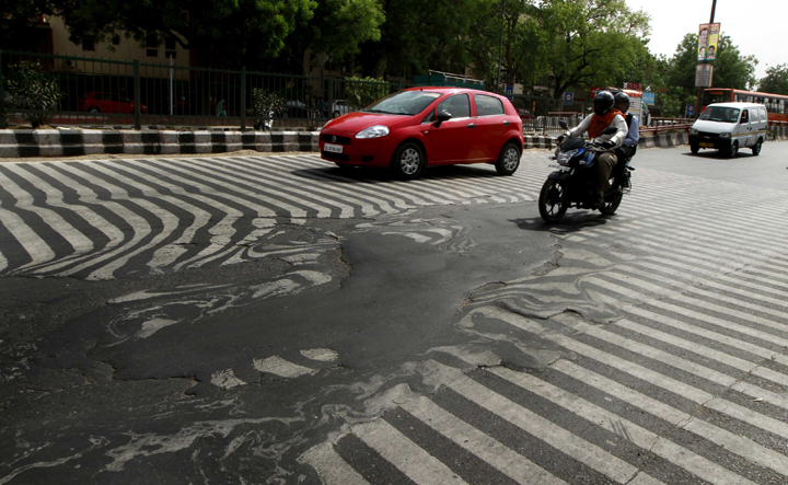 NEW DELHI, INDIA - MAY 24: A road melt near Safdarjung Hospital after the Temperature rise to 45 degree Celsius during a hot weather as Delhi/NCR experienced yet another scorching day, on May 24, 2015 in New Delhi, India. The national capital sizzling today as heat wave-like conditions prevailed across the city with mercury hovering above 45.3 degree Celsius, making life tough for the Delhiites. (Photo by Sanjeev Verma/Hindustan Times via Getty Images)