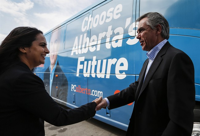 Alberta PC Party Leader Jim Prentice greets a supporter during a campaign stop in Calgary, Alta., Saturday, May 2, 2015.