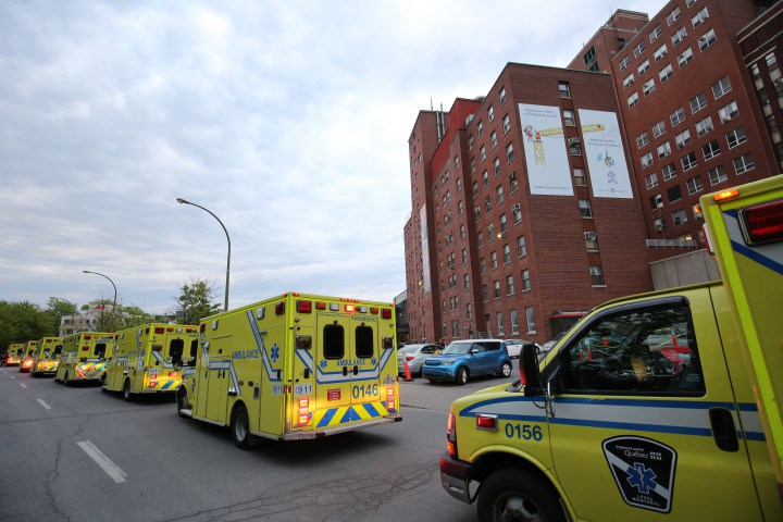 A lineup of ambulances surrounds 2300 Tupper Street as the Montreal Children's prepares for historic move. Montreal, May 24, 2015.