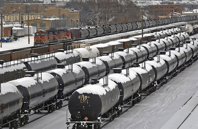 In this Dec. 31, 2013 file photo, oil cars are backed up in a yard in the aftermath of a train derailment in Mandan, N.D.