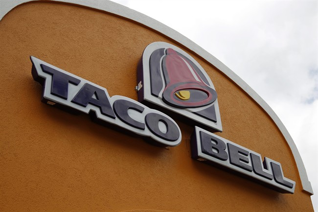 This Friday, May 23, 2014, file photo shows a sign at a Taco Bell in Mount Lebanon, Pa. Taco Bell and Pizza Hut say they're getting rid of artificial colors and flavors, making them the latest big food companies scrambling to distance themselves from ingredients people might find unappetizing.