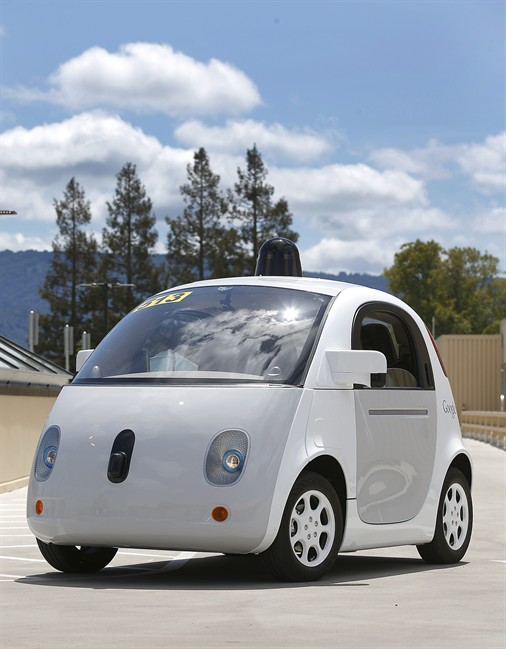 Google's new self-driving prototype car drives around a parking lot during a demonstration at Google campus in Mountain View, Calif. The car, which needs no gas pedal or steering wheel, has made its debut on public roads.